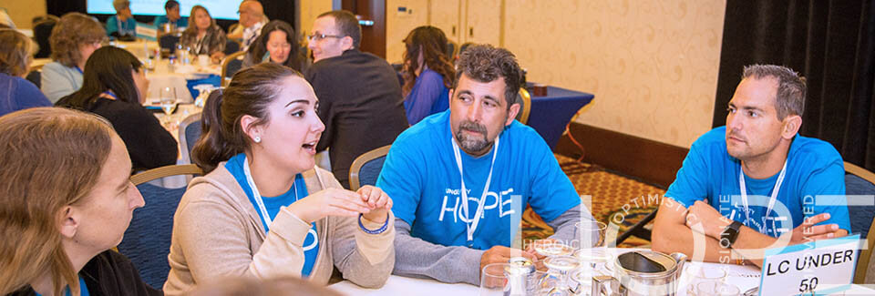 Attendees talking at a table during a session at LUNGevity's 2016 HOPE Summit