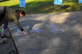 Volunteer chalks message of hope